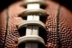 Close up picture of laces on a football