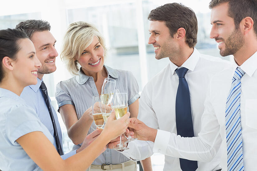 Group of happy business team toasting with champagne in the office