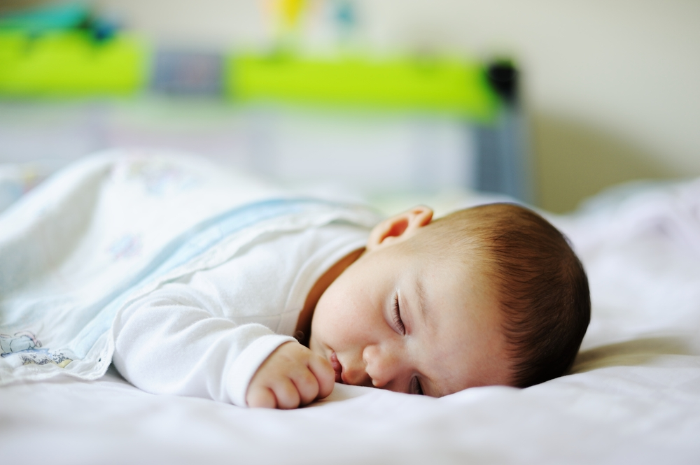 A little baby on sheet in his bed room-2
