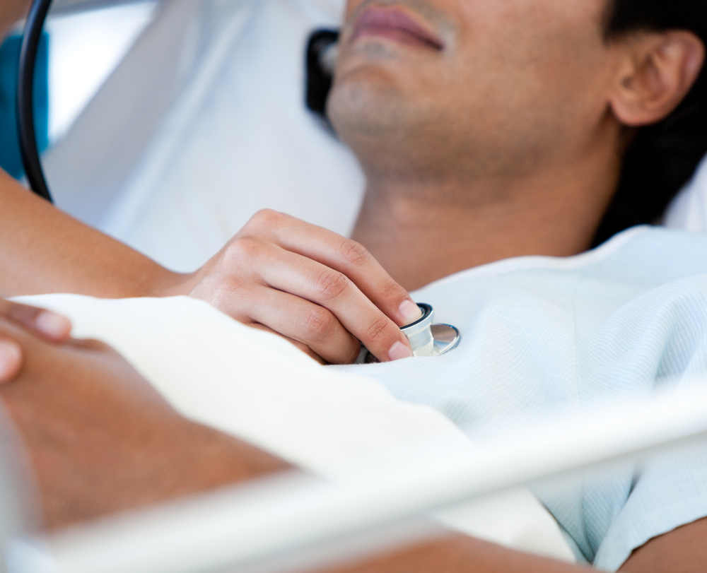 Close-up of a patient examinated by a doctor on a medical bed in the hospital