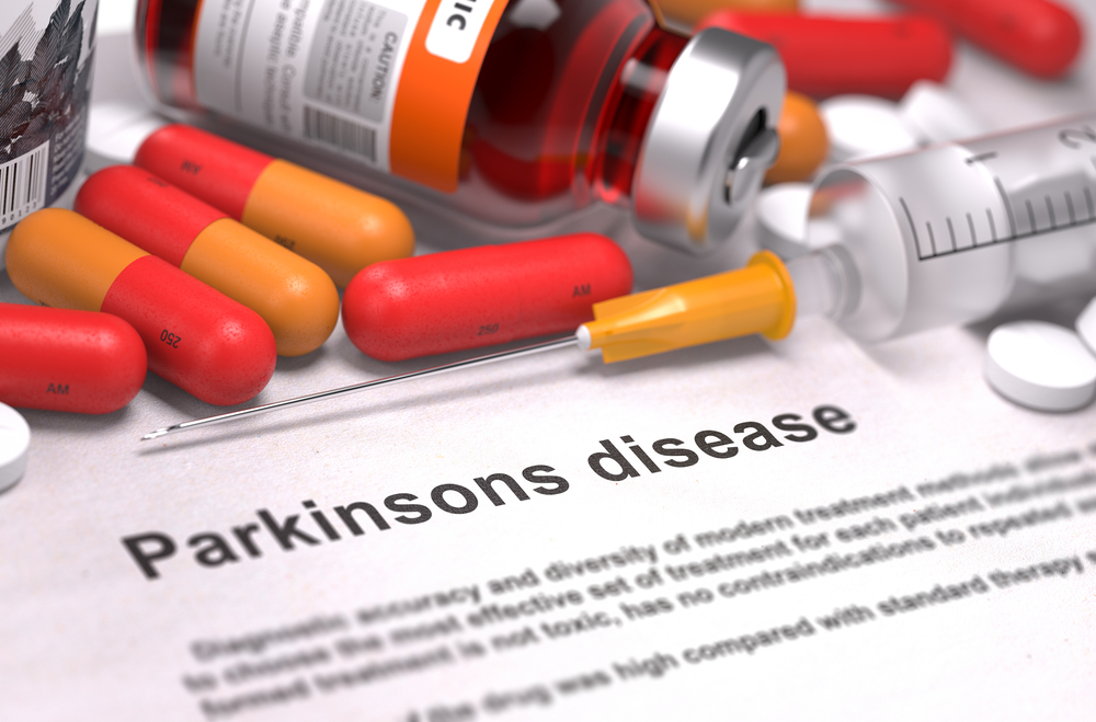 Diagnosis - Parkinsons Disease. Medical Concept with Red Pills, Injections and Syringe. Selective Focus. 3D Render.