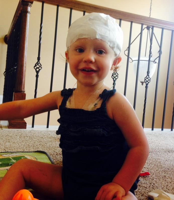 Pediatric_patient_with_happy_smile_and_head_wrap